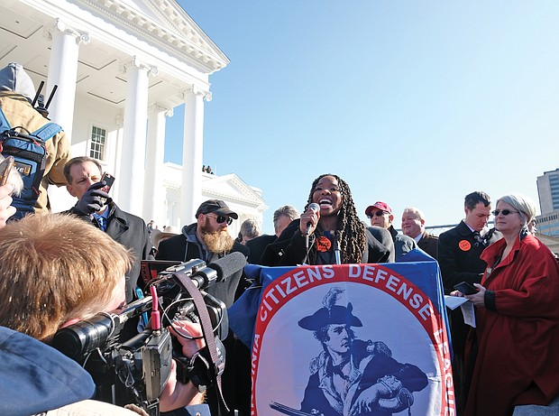 Antonia Okafor of Texas addresses the crowd inside Capitol Square, where guns were not allowed. She was the sole African-American speaker at the rally.