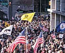 Thousands of demonstrators crowd Bank Street in Downtown, waving flags and signs during the Lobby Day rally by gun rights activists at the State Capitol on the Martin Luther King Jr. Holiday.
