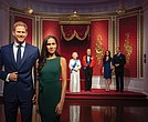 Figures of Britain's Prince Harry and his wife, Meghan Markle, are now situated apart from their original positions next to Queen Elizabeth II, rear from left, Prince Philip and Kate, the Duchess of Cambridge, and Prince William at Madame Tussauds Wax Museum in London following the couple's announcement earlier this month that they are stepping down as working royals.