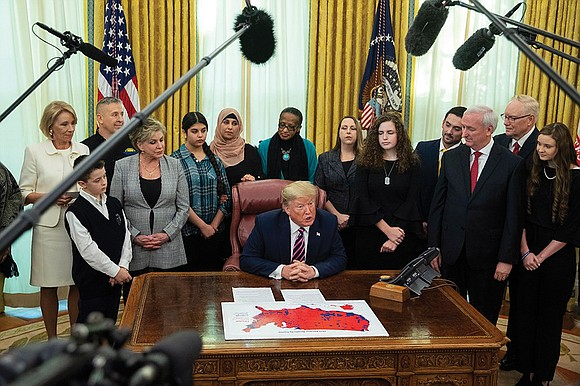 "President Trump, surrounded by schoolchildren of a variety of faiths, announced what he called ""historic steps to protect the First ..."