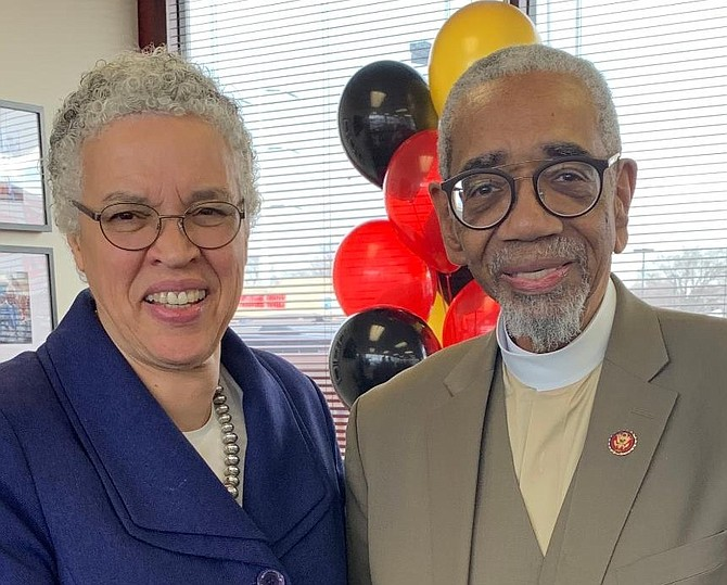 Cook County Board President Toni Preckwinkle congratulates US Congressman Bobby L. Rush on the opening of his re-election headquarters during Grand Opening celebration.