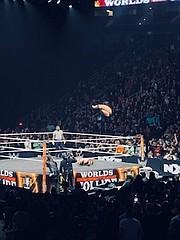"Finn Balor executing his ""Coup De Grace"" double Stomp finisher on his opponent, Ilja Dragunov"