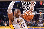 Kobe Bryant jumps almost as high as the rim to dunk the ball during a game against the Indiana Pacers in Los Angeles on Jan. 4, 2015.