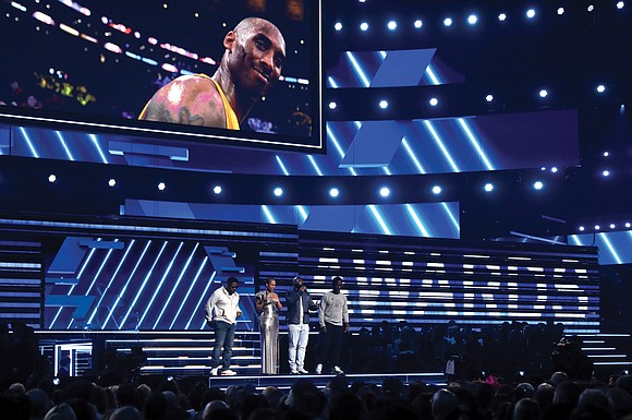 The Grammy Awards wasn't just about the music Sunday night. The show opened with a dedication to basketball icon Kobe ...