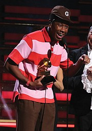 """Tyler, the Creator accept the Grammy Award for best rap album for """"Igor"""" during the ceremony televised from the Staples Center."""