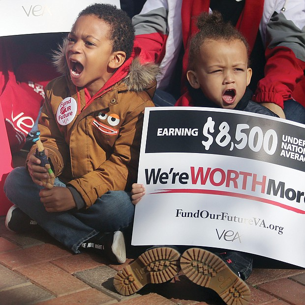 """Kenneth Henderson II, 4, left, and Zachary Watters, 3, lend their voices to a rally for more state funding for teachers and public education on Monday at the bell Tower at Capitol Square in Downtown. The youngsters were attending the """"Fund Our Future"""" rally with their mothers, Anasa Johnson and Ashleigh Watters, who are teachers with Richmond Public Schools and Petersburg Public Schools, respectively."""