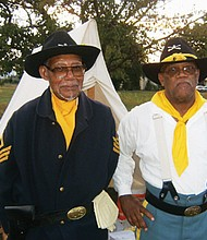 Pictured in historic U.S. Cavalry attire are the late Bill Morehouse (left) and Frazier Raymond, co-founders of the Moses Williams Pacific Northwest chapter of the Buffalo Soldiers. Raymond will present a history of the all-black Buffalo Soldiers in Clark County on Thursday, Feb. 6 at 7 p.m. at the Clark County Historical Museum in Vancouver.