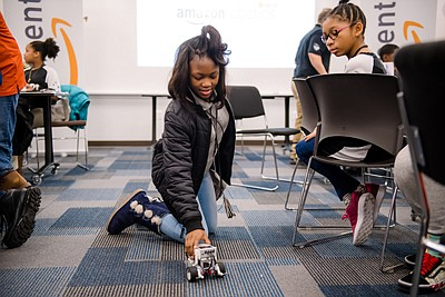 Amazon robots have come a long way – students from KIPP Ujima Village Academy learn about the evolution of robots over time on a tour of the Baltimore fulfillment center.