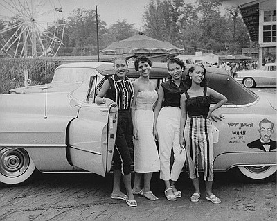"Young ladies pose with a vehicle owned by popular radio DJ, Charles ""Hoppy"" Adams of WANN radio in Annapolis."