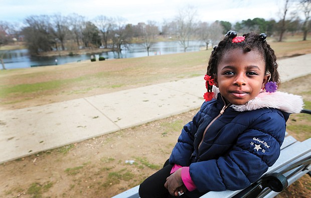 Spring-like weather this week led many people outside to enjoy the days before rain and chilly winter temperatures return. Shaya Scott, 5, perches on a bench at Swan Lake in Richmond's byrd Park where she was enjoying the weather, the ducks and Canada geese Tuesday with her parents, Shalaya and Larry Mceachin Jr., and her sisters.