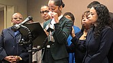 Jazmyne Childs, center, cries during a news conference in Raleigh, N.C., in September as she describes the sexual harassment she said she endured while working for the North Carolina State Conference NAACP. She filed a $15 million lawsuit Monday against the national NAACP, which she alleges condoned the behavior.