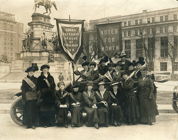 Members of the Equal Suffrage League of Virginia pose in front of the equestrian statue of George Washington in Richmond's Capitol Square in 1915.