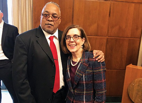 Oregon Gov. Kate Brown welcomes Portland Observer Publisher Mark Washington Sr. to her office at the Capitol in Salem last week for her proclamation signing ceremony in honor of Black History Month.