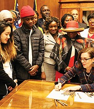 Oregon Gov. Kate Brown welcomes representatives of African American communities across the state to the state Capitol in Salem last week for her signing of a proclamation in honor of Black History Month. The contingency included members of the Oregon Commission on Black Affairs, the Oregon Black Pioneers, State Sen. Lew Frederick, and many others.
