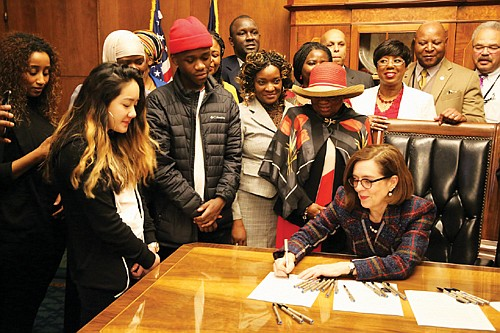 Oregon Gov. Kate Brown welcomes representatives of African American communities across the state to the state Capitol in Salem last ...