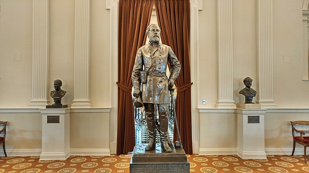 A statue of Confederate Gen. Robert E. Lee stands near the entrance to the Old House Chamber at the State Capitol. The chamber also features the busts of six other Confederate leaders.