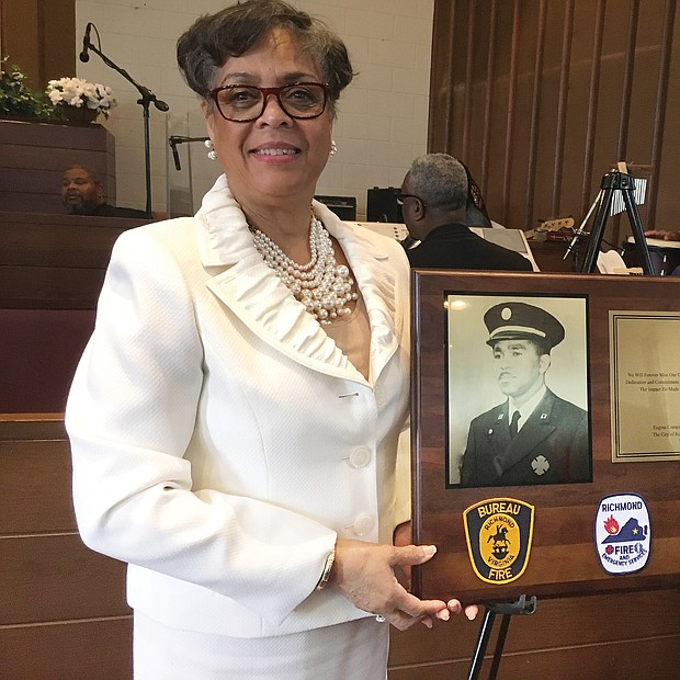 Raynell Reid shows off a tribute plaque to her late uncle, Richmond Fire Capt. Harvey S. Hicks II, during a ceremony last Sunday at Mosby Memorial Baptist Church. The ceremony marked the 70th anniversary of the hiring of the first 10 black firefighters in Richmond and Virginia. Capt. Hicks died June 4, 1963, attempting the daring rescue of a city resident who was trapped in a 23-foot-deep pit. The church joined with Engine Company No. 9 and Associates, a nonprofit group that works to call attention to the city's pioneering black firefighters and police officers, on the Black History Month program. Richmond hired the first black police officers in 1946 and the first black firefighters in 1950. At the time of his death, Capt. Hicks also was studying for the ministry and was to preach his trial sermon a few days later. As part of Sunday's commemoration, Dr. Price L. Davis, pastor of the church at 2901 Mechanicsville Turnpike, preached the sermon that the firefighter had written.