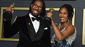 "Matthew A. Cherry and Karen Rupert Toliver show off their Oscars awarded for best animated short film for ""Hair Love"" during last Sunday's Academy Awards ceremony in Los Angeles."