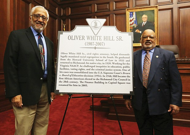 Two Richmond lawyers, Oliver W. Hill Sr. and Spottswood W. Robinson III, who were at the center of the battle for civil rights, are being remembered with state historic markers. Dr. Oliver W. Hill Jr. stands beside the marker to his late father that was unveiled in a ceremony Feb. 6 at the Lewis F. Powell Jr. United States Courthouse in Downtown. With him is J. Maurice Hopkins, a member of the Midlothian-based Oliver White Hill Foundation.