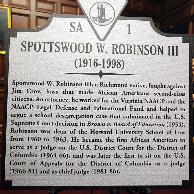 This is the marker to Mr. Hill's late law partner, Judge Robinson, who went on to break color barriers in the federal court system and rise to become chief judge of the powerful U.S. Court of Appeals for the District of Columbia. Mr. Hill and Judge Robinson played key roles in the landmark 1954 Brown v. Board of Education decision by the U.S. Supreme Court that struck down government-sanctioned racial segregation of public schools and led to other landmark civil rights laws.