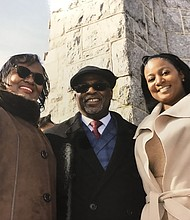 Pastor Johnson pictured with his wife (left) the Rev. Robin D. Johnson, and youngest daughter Amanda (right).