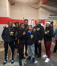 """Mack Papi Allison IV (back center); Mack Allison III (second from the right) with young boxers from the Time 2 Grind Gym: Javonte Berry; Davon Evans; Arnold Manigault Jr.; Zorian Clark; and Destiny """"Lady Tyson"""" Day Owens."""