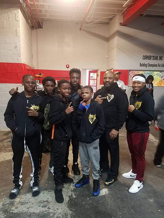 "Mack Papi Allison IV (back center); Mack Allison III (second from the right) with young boxers from the Time 2 Grind Gym: Javonte Berry; Davon Evans; Arnold Manigault Jr.; Zorian Clark; and Destiny ""Lady Tyson"" Day Owens."