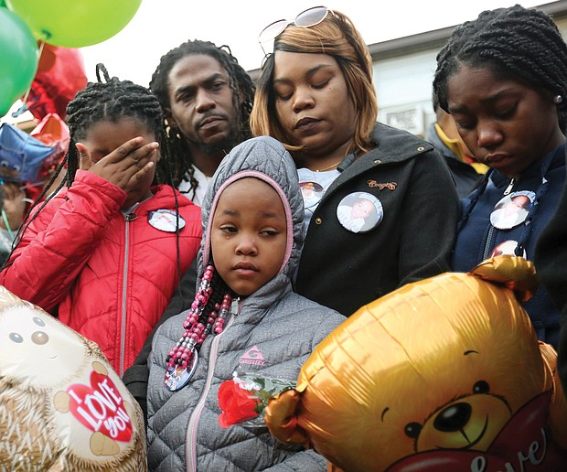 Shamar's grieving family joins mourners at the vigil — parents Sharmar Hill Sr. and Shaniqua Allen, center rear; and sisters, from left, Len'Naveya Smith, 10; Len'Niesha Smith, 7; and Ni'Aveya Allen, 14. The youngster's death has touched the community, with hundreds of people, including Gov. Ralph S. Northam, Mayor Levar M. Stoney and Richmond Police Chief Will Smith, attending his funeral Monday at New Life Deliverance Tabernacle on Decatur Street. No arrest has been made yet in the youngster's death.