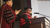 Delegate Luke e. Torian of Prince William County, right, receives a standing ovation following his keynote address last Friday at Virginia union university's 155th Anniversary Founders Day Convocation. Joining in the applause is Vuu President Hakim J. Lucas.