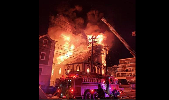 A fire tore through an Elizabeth, New Jersey church overnight into Sunday morning, according to officials.