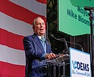 Democratic presidential candidate Michael Bloomberg, who apologized for the controversial police stop-and-frisk policy during his tenure as New York's mayor, addresses Virginia Democrats during the Blue Commonwealth Gala last Saturday in Richmond.