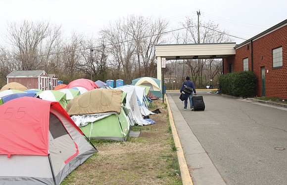 Money and comfort are among the reasons that the homeless encampment across from the Richmond Justice Center is still standing ...