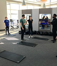 Let's Go Fitness trainers Jeff Morton and Stacey Roach coached attendees through rounds of cardio exercises on Saturday, February 15, 2020 at Luminary at One Light.