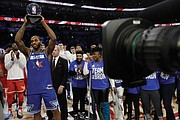 Kawhi Leonard of the Los Angeles Clippers holds up the Kobe Bryant MVP Award he won for his spectacular effort on Team LeBron in the All-Star Game.
