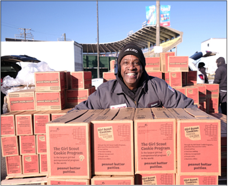 Duane Brannon shows off the boxes of Girl Scout cookies he and other volunteers from Dunmar Moving helped unload last Saturday at The Diamond on behalf of the area Girl Scouts of the Commonwealth of Virginia. The ballpark in North Side was one of three drop-off spots for the 1 million boxes of Thin Mints and other Girl Scout cookie favorites that are being delivered and sold through the end of March. Youth members and supportive adults came to those points to pick up the cookies for delivery to customers.