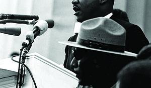 Martin Luther King Jr. (at podium)