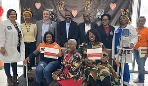 """BMS Family Health & Wellness Centers leadership and staff with Assembly Member Latrice Walker (front row, seated far right); BMS CEO Harvey Lawrence (back row, fourth from left). More than 100 patients were screened at BMS """"Take the Pressure Off!"""" event on February 20th."""