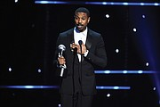 "Michael B. Jordan accepts the award for best actor in a motion picture for his role as crusading Harvard-educated attorney Bryan Stevenson in the movie ""Just Mercy."" The film's co-star, Jamie Foxx, won an Image Award for best supporting actor."