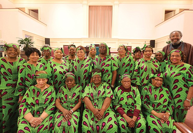 Members of Providence Park Baptist Church's Seniors Ministry show off their dresses made from West African cloth. The dresses, which feature the ministry's colors of lime, green and purple, represent a tribute to the members' African heritage and symbolize their efforts to promote African-American history and culture during February and throughout the year. Joining them last Sunday is Dr. Jerome C. Ross, right, pastor of the church on East Ladies Mile Road in North Side.