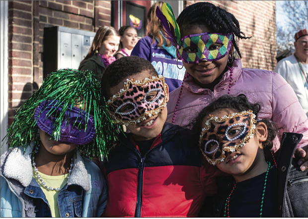 There's nothing like a colorful mask and beads to get into the spirit of Mardi Gras. youngsters, from left, Kendall Lewis, 5; Qaiden Lewis, 6; Mekiyan Clanton, 11; and Khalil Abraham, 4, are ready for the festivities last Saturday at Dogtown Dance Theatre's 10th Annual Mardi Gras RVA, which kicked off with a parade.