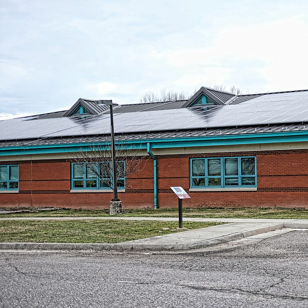 """On a clear or cloudy day, several Richmond schools are generating energy to help power their facility. Here, solar panels on the roof of Lucille M. Brown Middle School on Jahnke Road in South Side are the latest effort by Richmond Public Schools to """"Go Green"""" and cut energy costs. Richmond Public Schools Superintendent Jason Kamras, Gov. Ralph S. Northam and other officials held a news conference last Friday at the school to announce that the last of 10 city schools now have solar panels. The panels will produce enough electricity to cover about 24 percent of the schools' electrical needs. The $2.9 million project, which also includes an energy monitoring system, was completed during the summer and was paid for by a grant from RVA Solar Fund, part of the Community Foundation for a Greater Richmond, and were developed by Secure Futures Solar, a clean energy company. The panels will save RPS approximately $2 million in utility costs over the next 20 years, or about $100,000 annually, officials said. Officials said it is the largest solar energy system at a K-12 school division in Virginia to date. The other city schools with solar panels are Huguenot High School, Martin Luther King Jr. Middle School and Oak Grove, Miles J. Jones, Linwood Holton, Blackwell, Fisher, Broad Rock and G.H. Reid elementary schools."""