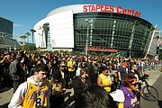 Many of the thousands of fans who attended Monday's public remembrance event for the former Los Angeles Lakers star Kobe Bryant and his daughter, Gianna, dressed in the team colors of purple and yellow.