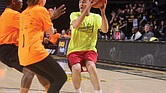 Gov. Ralph S. Northam looks for an open teammate to pass the ball to last Thursday during the 12th Annual Capitol Square Basketball Classic at Virginia Commonwealth University's Siegel Center. The event was a fundraiser for VCU's Massey Cancer Center.