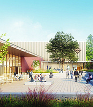 An artist's rendering shows a new courtyard and buildings for the future De La Salle North Catholic High School at St. Charles Parish in the Cully Neighborhood near Northeast 42nd and Killingsworth. The former St. Charles School is on the right and proposed new buildings for the high school are on the left.