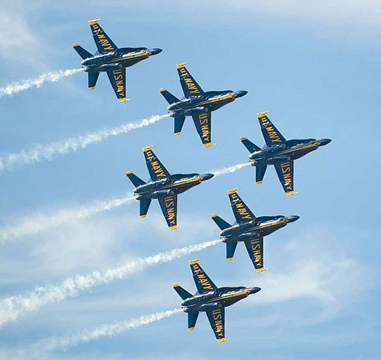 The famous Blue Angels, along with...