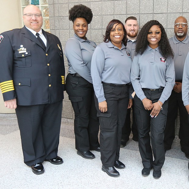Seven new graduates of the Richmond Department of Emergency Communications' 33rd Basic Dispatch Academy celebrate after a ceremony last Friday at the Richmond Police Training Academy. The new graduates are, from left, Stephanie Z. Franklin, Kyna Meadows, Joseph Kearns, Zakiya St. Dic, Woody Winborn, Safiyyah Muslima Bint Abdul Malik and Justin Fleming. They are flanked at left by Stephen M. Willoughby, director of the Department of Emergency Communications, and at right by Ortoria Hymons, the department's acting training supervisor. The graduates began their training on Jan. 6 with classroom sessions on dispatch procedures, public safety terminology, handling difficult callers and active shooter situations and fires, and various policies and procedures. They practiced answering 911 emergency calls, rode along with Richmond Police officers and passed several tests to make it to graduation. Now they must complete hundreds of hours of on-the-job training before they can work independently taking 911 calls and dispatching help.