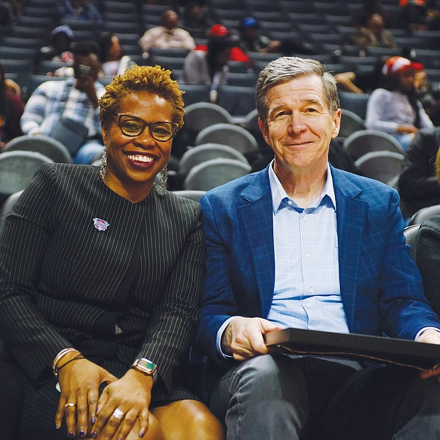 CIAA Commissioner Jacqueline McWilliams and North Carolina Gov. Roy Cooper are on the sidelines at the Spectrum Center during the tournament. The CIAA was celebrating its 75th anniversary this year.