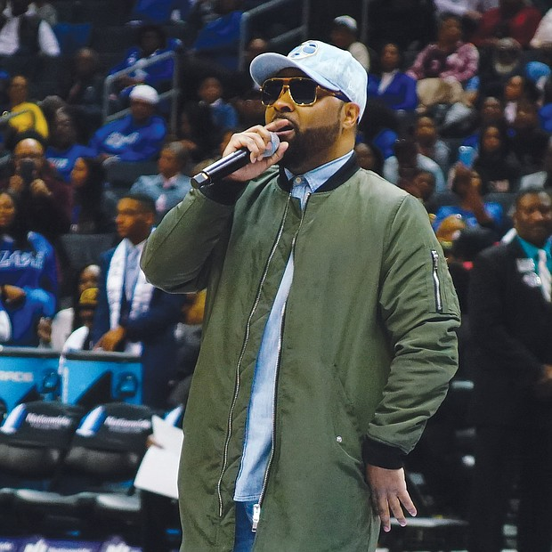 Musiq Soulchild turns it up during the women's game halftime before an appreciative crowd of more than 8,000 fans at the Spectrum Center.