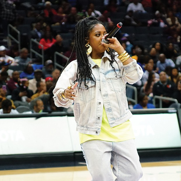 Rapper Rapsody throws down a solid groove during halftime of the men's final.