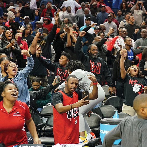 Rams fans raise the roof at the Spectrum Center in Charlotte, N.C., as the Winston-Salem State team pulls out a victory in the final minutes of the championship game.